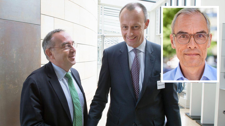 Links:Norbert Walter-Borjans (SPD) zusammen mit Friedrich Merz (CDU)