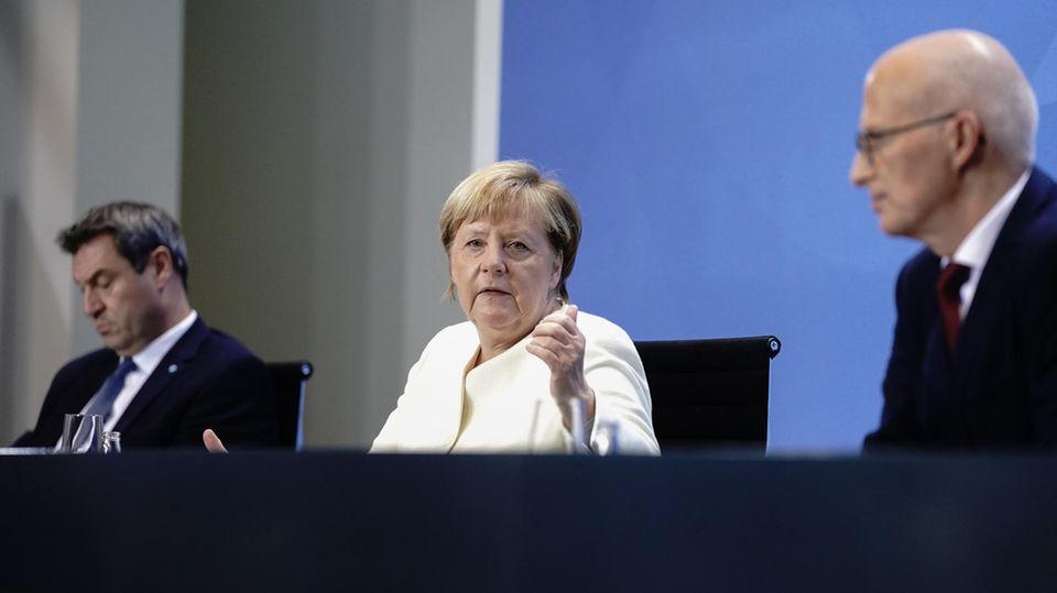 Markus Söder, Angela Merkel und Peter Tschentscher (v.l.n.r.)