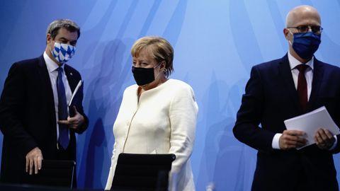 Von links: Markus Söder, Bundeskanzlerin Angela Merkel und Peter Tschentscher