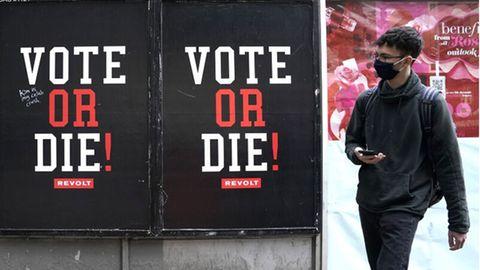 """Mann läuft an Sean """"Diddy"""" Combs' berühmter """"VOTE or DIE!""""-Initiative vorbei."""