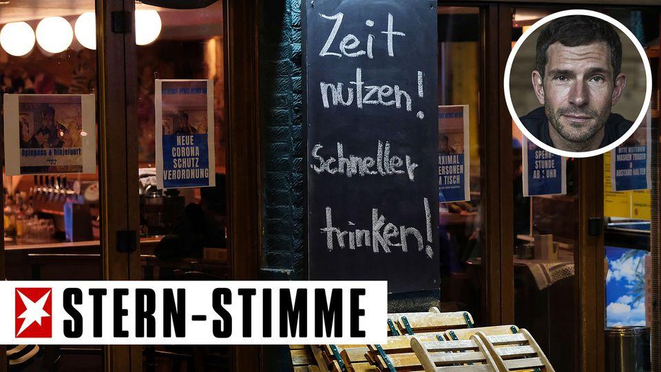 """Ein KölnerGastwirt wirbtkurz vor der Sperrstunde mit dem Slogan """"Zeit nutzen! Schneller trinken!"""" für sein Lokal"""