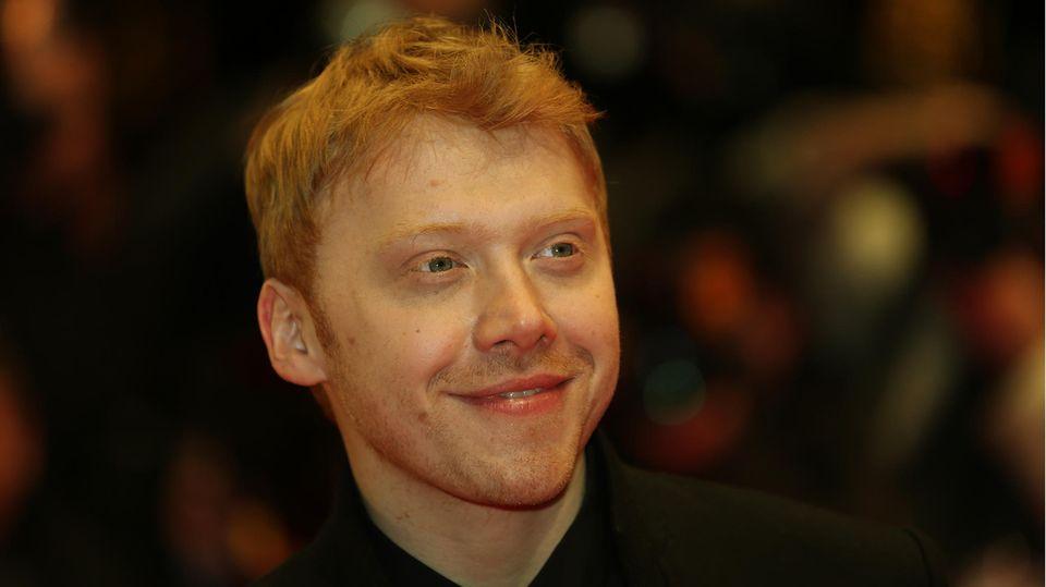 Rupert Grint lächelt