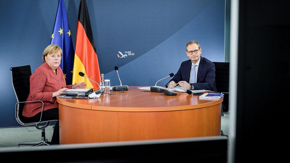 Bundeskanzlerin Angela Merkel (CDU) und Berlins Regierender Bürgermeister Michael Müller (SPD)