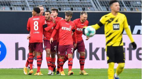 Kölns Ellyes Skhiri feiert mit Teamkameraden das erste Tor gegen den BVB