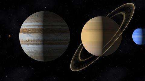 Eine Computergrafik, die dei Planeten Jupiter und Saturn zeigt