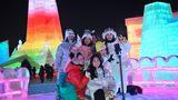 Posen für ein Erinnerungsfoto: Nach dem Coronajahr ist der Wintertourismus in China bereits wieder angelaufen.